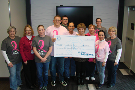 In December 2015, the Kirkwood Bookstore and EagleTech presented EFY with a check for $957.62 in proceeds from the pink and gray shirts they are wearing. Thank you!