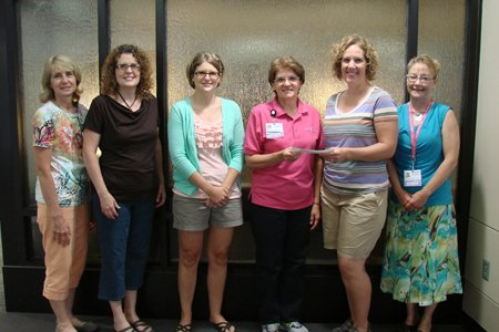 Members of Omicron Phi Sorority presented a check for $600 to EFY leaders on September 6, 2013. The group holds an annual Bunco event fundraiser with proceeds supporting the breast-care services covered by the EFY Fund. More than 30 people participated in the 2013 Bunco event.